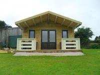 Externally clad 45mm log cabin